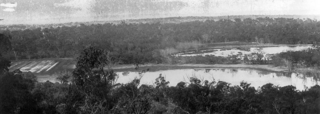 Panorama taken in 1921 from One-Tree (Reabold) Hill over West Lake (foreground) and East Lake (middle distance on the right).  The photo was taken during one of the wettest periods on record.  Dead mature trees around both lakes suggest a recent rise in water levels.  Formal water level monitoring at Perry Lakes (West Lake) commenced in 1963.  Copyright holder unknown, reproduced by permission Town of Cambridge.