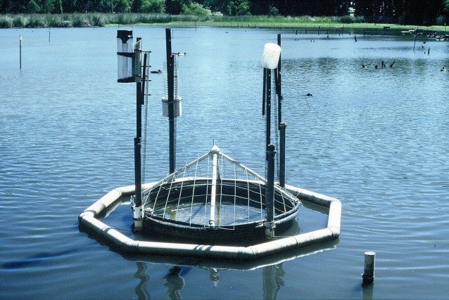 Floating Class A evaporation pan in operation.  This simple yet rigorous and independent measure of lake evaporation allowed us to resolve the sediment heat flux, a component usually ignored and demonstrate that in shallow wetlands and lakes, sediment heat flux is a significant component of the thermal balance.