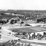 Aerial view looking NNW East Lake on the left and stadium site to the right circa 1961.