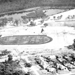 Aerial view looking NW across stadium site to East Lake circa 1961.
