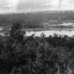 View of Perry Lakes 1921 taken from One-tree (Reabold) Hill.  The photo appears to have been taken in winter.  Both lakes are almost fully flooded.  Dead mature trees around both lakes suggests a recent rise in lake levels (and the unconfined aquifer).  Alderbury Flats (left) appear to have been cultivated and are partially flooded.  View looking east, West Lake in foreground, East Lake behind.  This photo appears in Chapter 2 as Plate 2.2.