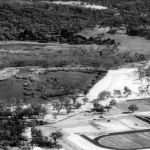 East Lake with stadium and warm up tracks in place.  The photo was probably taken in summer as the NE basin in East lake is now dry and the water level in the southern part of the lake is lower.  An old fence line is clearly visible (refer Chapter 2, Figure 2.15).  This photo appears in Chapter 2 as Plate 2.7.